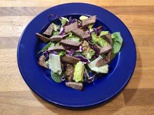 steak salad on blue plate