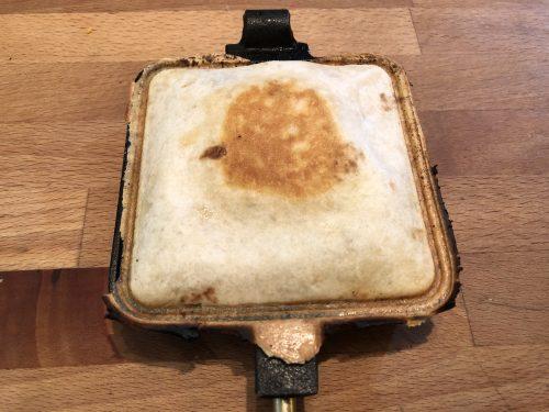 cooked tasty taco in pie iron