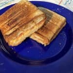 egg and cheese sandwich on blue plate made in pie iron