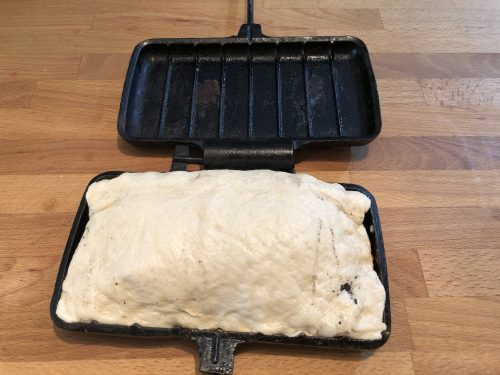 pizza dough folded over to form pocket in pie iron