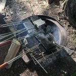 Variety of pie irons on campfire