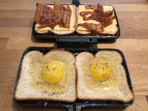 egg sandwich with bacon and cheese added