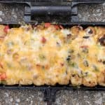cheesy tots baked in a pie iron