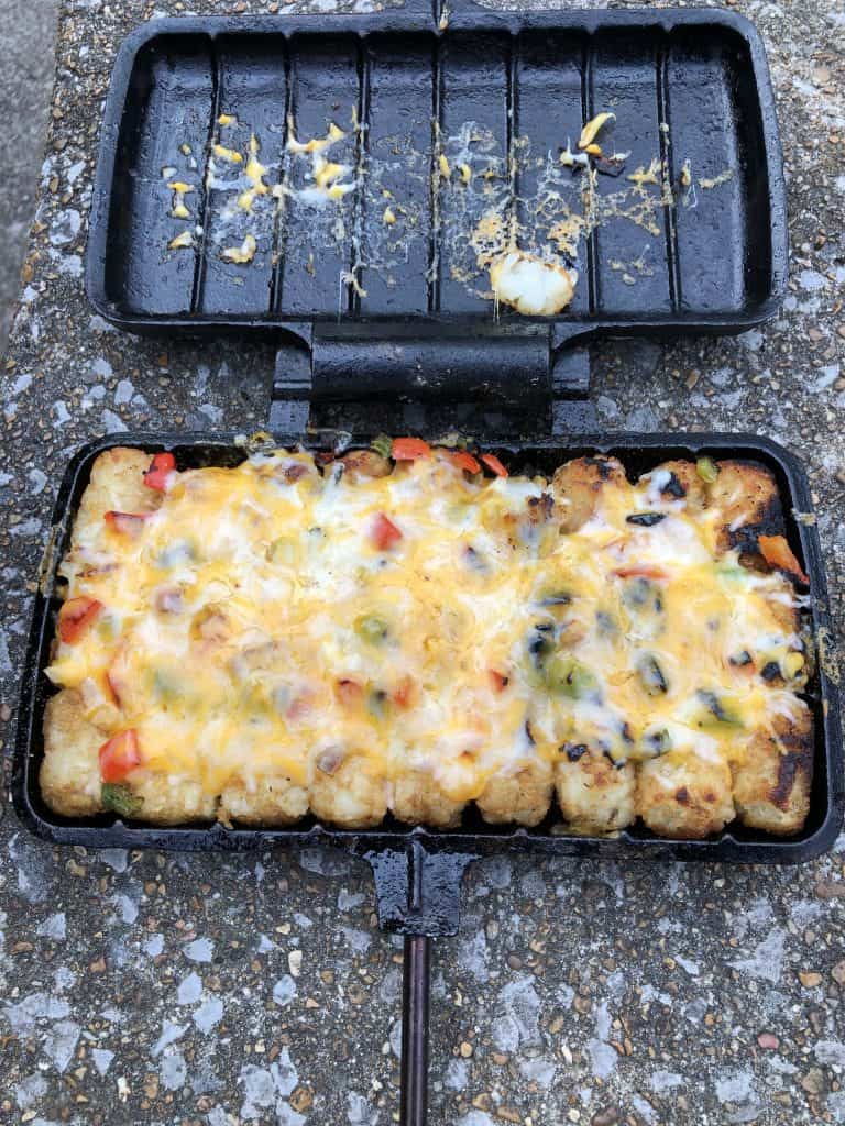 finished cheesy tots in pie iron