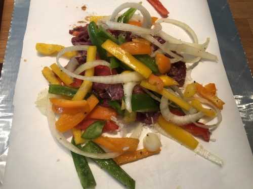 peppers and onions on steak and rice