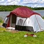 maroon and white cabin tent set up for family camping