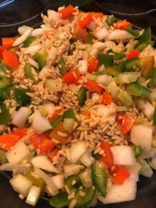 peppers, onions, and celery stirred in
