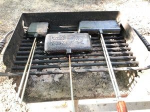 pie irons set over the grate at the campsite