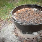 camp kitchen kit - blueberry cobbler cooking on charcoal