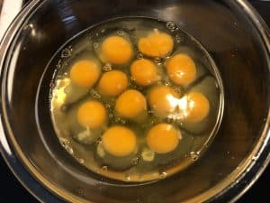 12 eggs cracked in a bowl