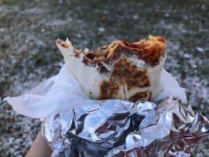camping breakfast burrito being eaten