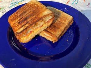 breakfast sandwich on blue enamalware plate