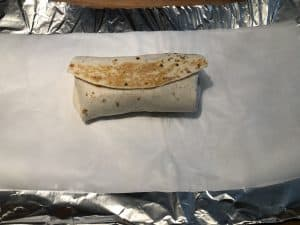 toasted camping breakfast burrito ready to wrap