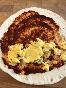 scrambled eggs on tortilla with pureed chipotle