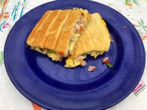 ham and cheese omelet pocket on blue plate