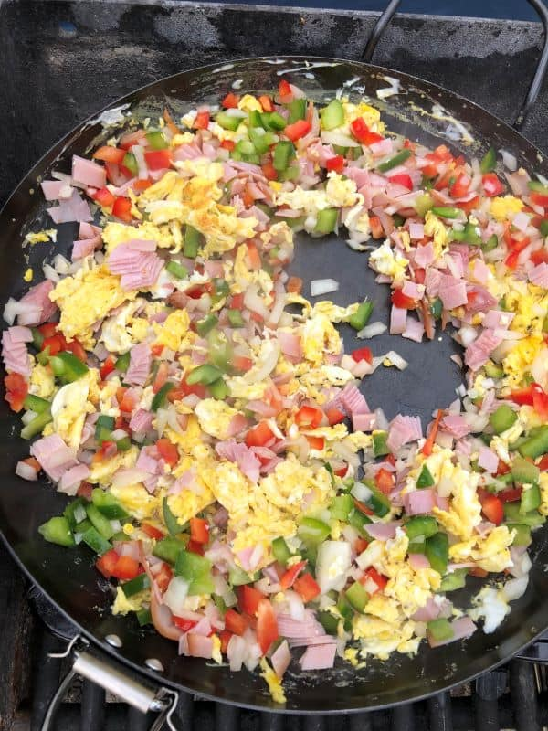 eggs, ham, peppers, onions scrambled in skillet