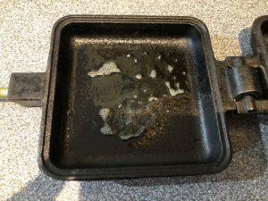square pie iron sprayed with cooking spray