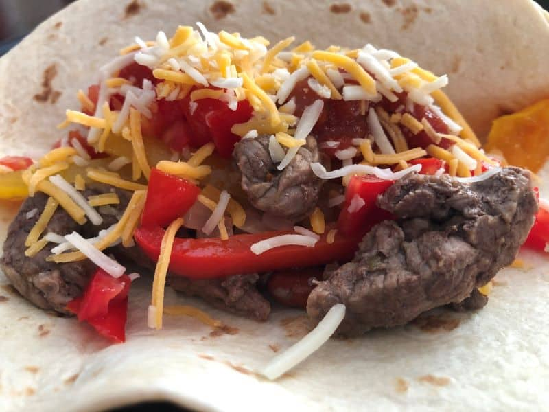 steak peppers and onions cooked as fajitas in foil packets