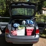 open rear of car packed for camping