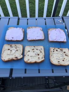 mixed berry cream cheese spread on three slices of cinnamon bread with three plain slices