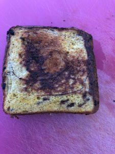pie iron french toast sandwich done cooking