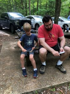 adult and child whittling