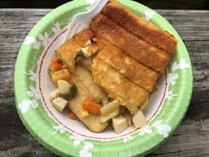 chicken pot pie cooked in a pie iron plated in green bowl