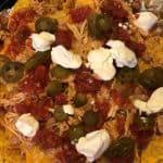 nachos baked in a dutch oven over the campfire